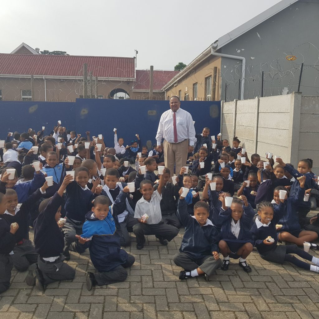 90th Celebrations – learners getting some cake and cool drink